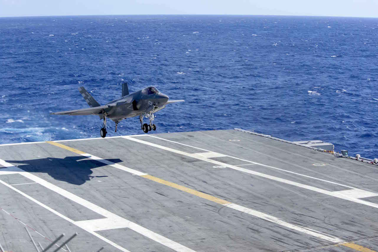 151003-N-QD363-164 ATLANTIC OCEAN (Oct. 3, 2015) An F-35C Lightning II carrier variant joint strike fighter assigned to the Salty Dogs of Air Test and Evaluation Squadron (VX) 23 prepares to make an arrested landing aboard the aircraft carrier USS Dwight D. Eisenhower (CVN 69). The F-35C Lightning II Pax River Integrated Test Force is currently conducting follow-on sea trials aboard the Eisenhower. (U.S. Navy photo by Mass Communication Specialist 3rd Class Jameson E. Lynch/Released)