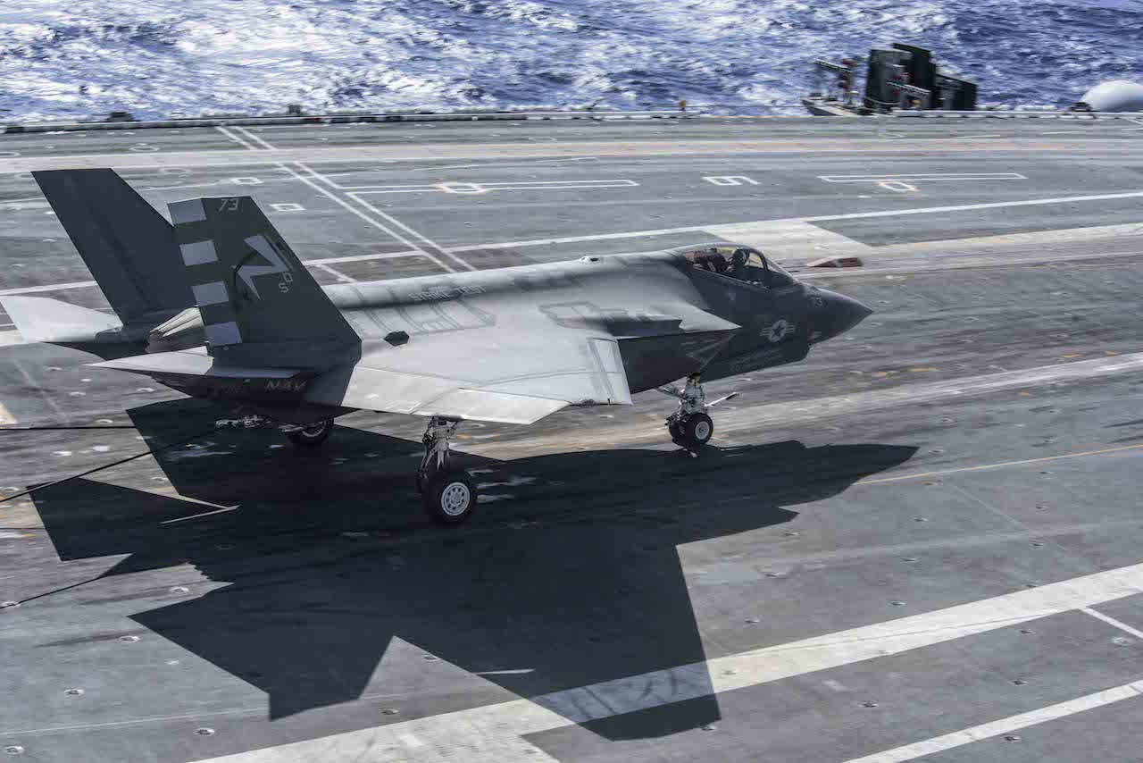 151003-N-QD363-165 ATLANTIC OCEAN (Oct. 3, 2015) An F-35C Lightning II carrier variant joint strike fighter assigned to the Salty Dogs of Air Test and Evaluation Squadron (VX) 23 makes and arrested landing aboard the aircraft carrier USS Dwight D. Eisenhower (CVN 69). The F-35C Lightning II Pax River Integrated Test Force is currently conducting follow-on sea trials aboard the Eisenhower. (U.S. Navy photo by Mass Communication Specialist 3rd Class Jameson E. Lynch/Released)